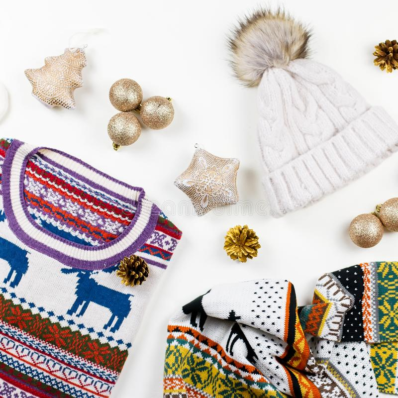 Christmas mood composition with Christmas sweater, hat, presents and lights. Winter concept flat lay, top view stock images