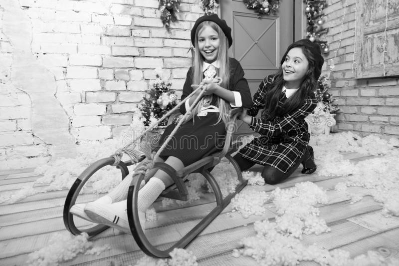 Christmas mood. Happy new year. Winter. Christmas tree and presents. xmas online shopping. Family holiday. The morning. Before Xmas. Little girls on sleigh stock image