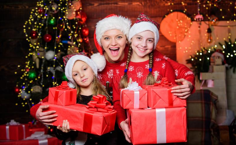 Christmas morning routine for moms. Mom hug daughters near christmas tree. Happy family concept. Wonderful moments. Christmas. Achieve impeccable christmas day stock image