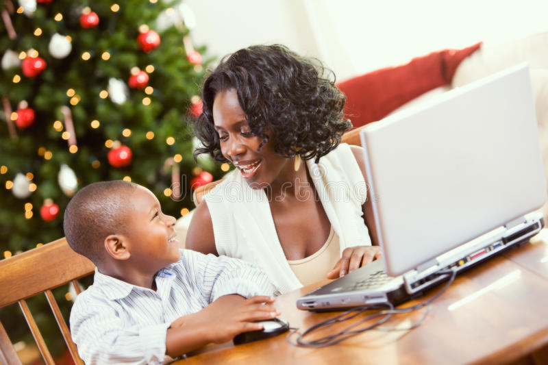Christmas mother helping boy write santa letter on computer stock download christmas mother helping boy write santa letter on computer stock image image of publicscrutiny Images