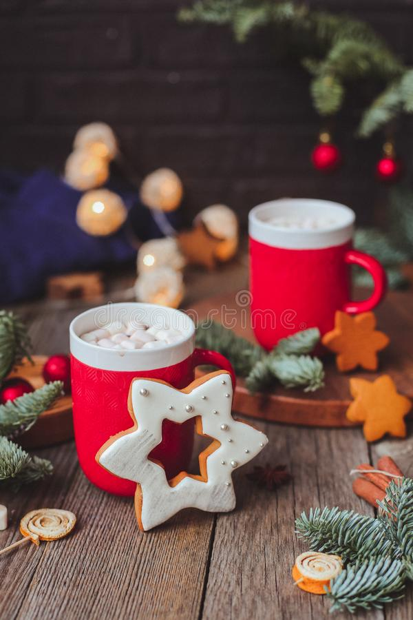 Christmas mug with hot cocoa sparkling bengal fire work lights, and festive decorations. Christmas.tree lights bokeh in royalty free stock image