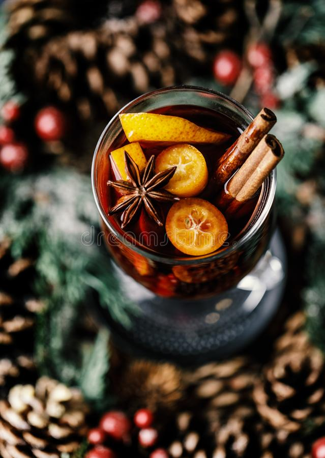 Christmas mulled red wine with spices, cranberry and fruits. Traditional Christmas hot drink. Christmas drink background royalty free stock photography