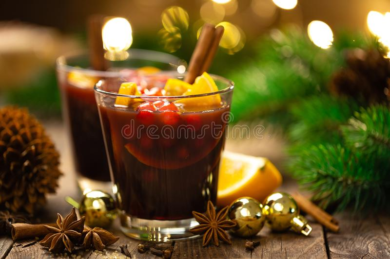 Christmas, New Year, Xmas mulled red wine with spices, cranberry and oranges. Traditional hot drink or beverage stock photo