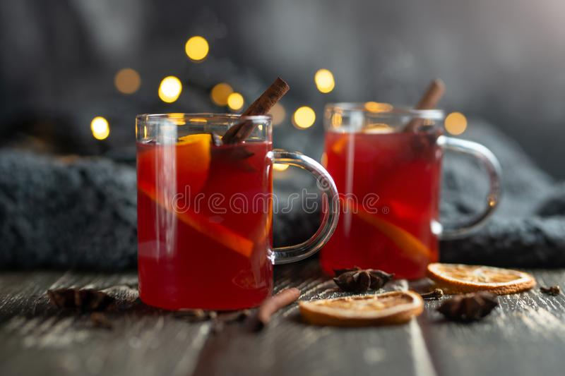 Christmas mulled red wine with spices and fruits on a wooden rustic table. Traditional hot drink in the New Year, with festive royalty free stock photos
