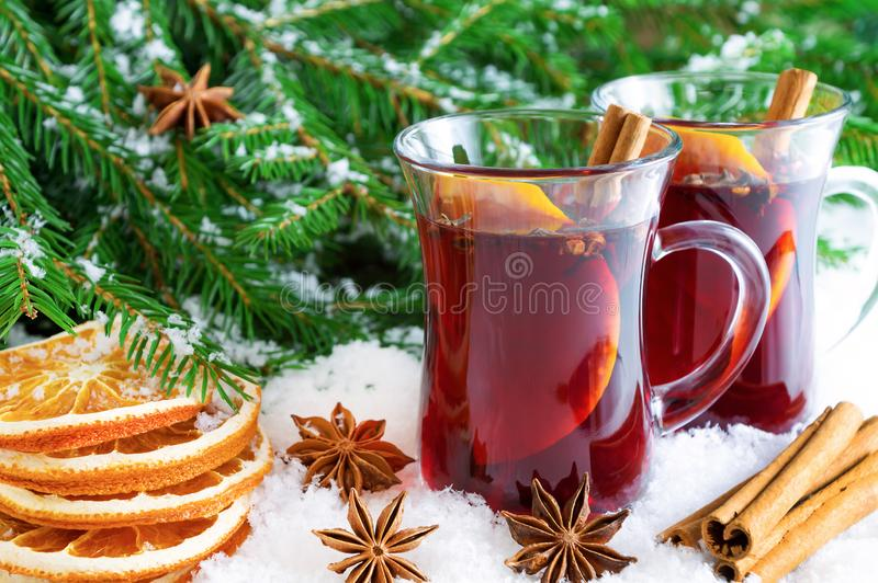 Christmas mulled red wine with spices and oranges stock image