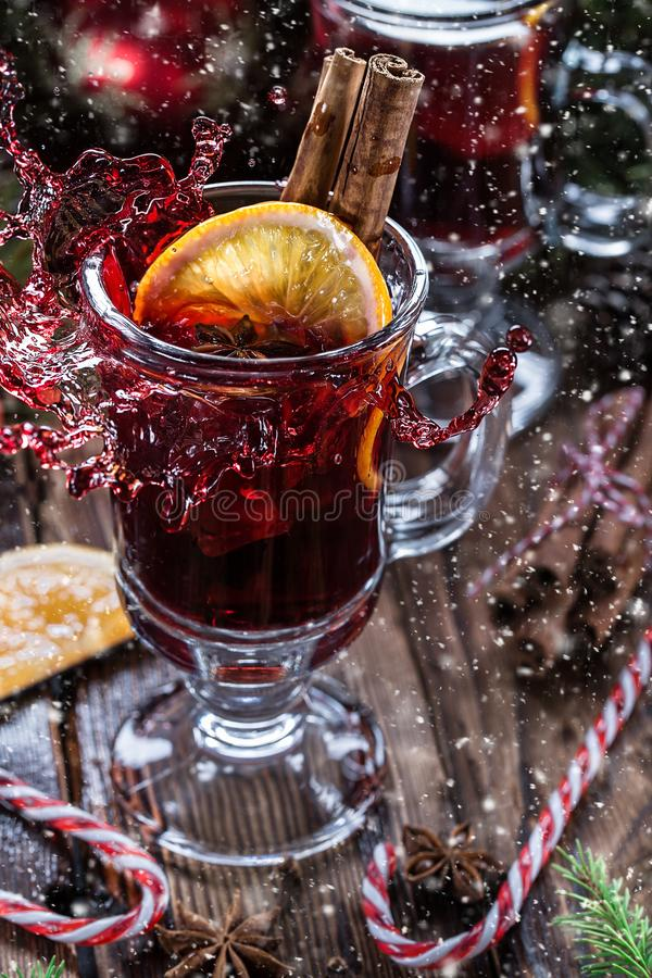 Christmas mulled red wine with spices and oranges stock photo