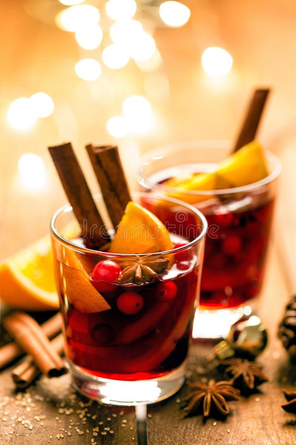 Christmas mulled red wine with spices and oranges on a wooden rustic table. Traditional hot drink at Christmas time royalty free stock photos