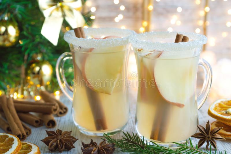 Christmas mulled white wine with spices and and apples royalty free stock photo