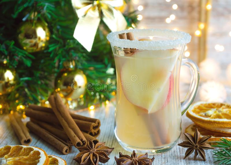 Christmas mulled white wine with spices and and apples royalty free stock photography
