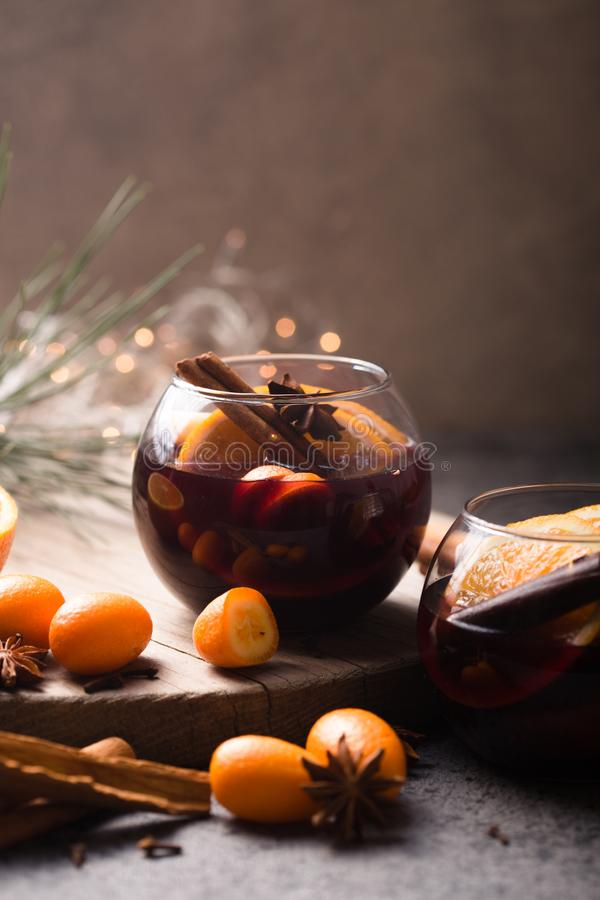 Christmas mulled wine  in circle glasses delicious holiday like parties with orange cinnamon star anise spices. Traditional hot stock photo