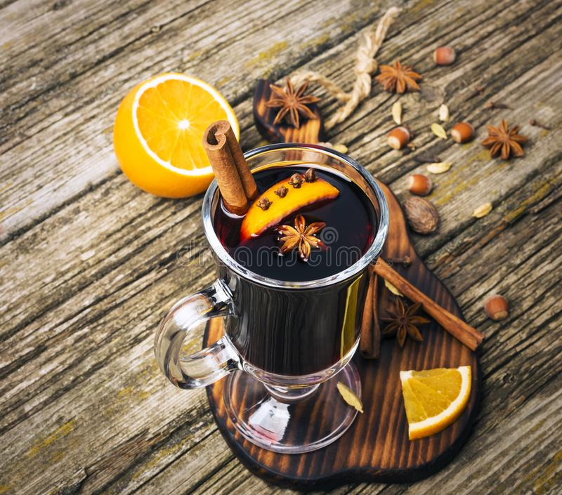 Christmas mulled wine in glass cup on a wooden table stock image
