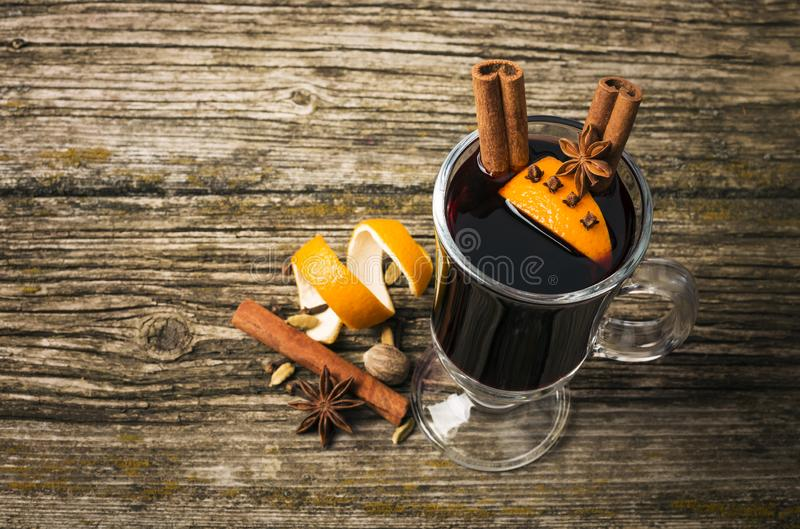 Christmas mulled wine in glass cup on a wooden table stock photos