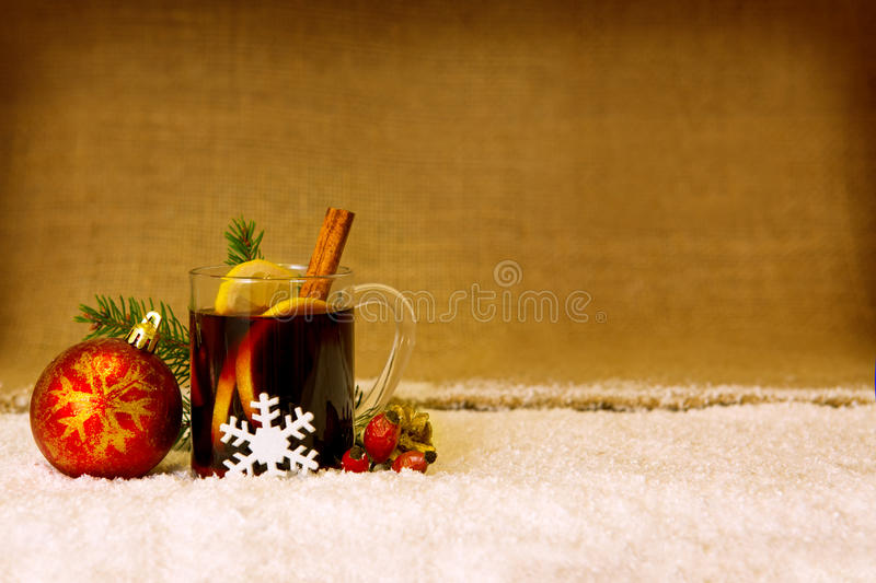 Christmas mulled wine and red ball. stock photography