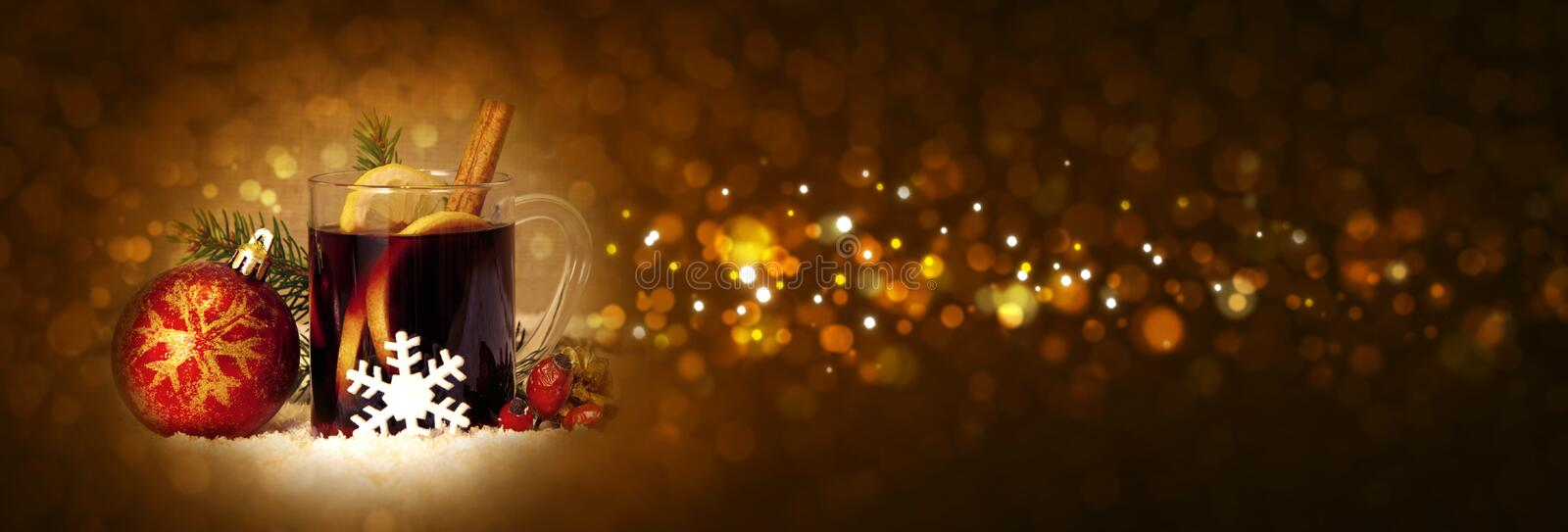 Christmas mulled wine and red ball. stock image