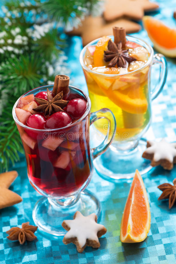 Christmas mulled wine and spiced apple cider on blue background. Christmas mulled wine and spiced apple cider on a blue background, vertical, close-up stock photography