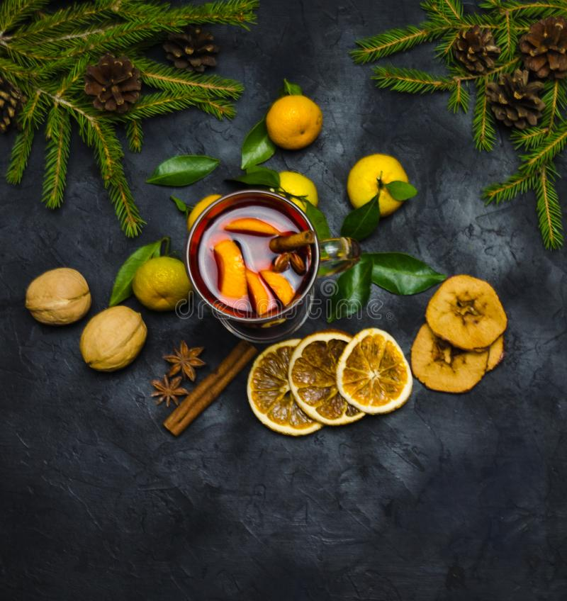 Christmas mulled wine with spices and oranges and tangerines on a wooden rustic table. Traditional hot drink for Christmas royalty free stock photography