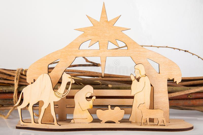 Christmas Nativity Scene of baby Jesus in the manger with Mary and Joseph in silhouette surrounded by the animals. And wise men with the city of Bethlehem in royalty free stock image