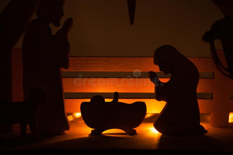 Christmas Nativity Scene of baby Jesus in the manger with Mary and Joseph in silhouette surrounded by the animals. And wise men with the city of Bethlehem in royalty free stock photos