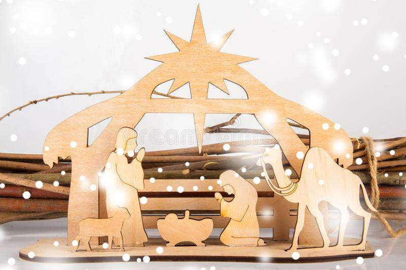 Christmas Nativity Scene of baby Jesus in the manger with Mary and Joseph in silhouette surrounded by the animals. And wise men with the city of Bethlehem in royalty free stock photography