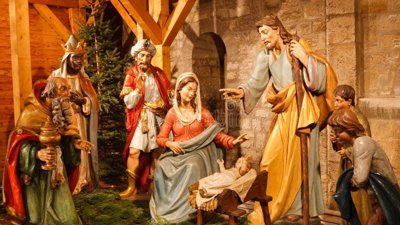 Christmas Nativity Scene: Baby Jesus, Mary, Joseph. Christmas Nativity Scene with Three Wise Men Presenting Gifts to Baby Jesus, Mary & Joseph royalty free stock photos