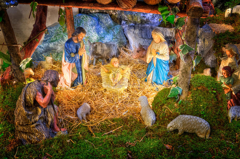 Christmas nativity scene with baby Jesus, Mary & Joseph in barn. With flock of sheeps and shepherds stock images