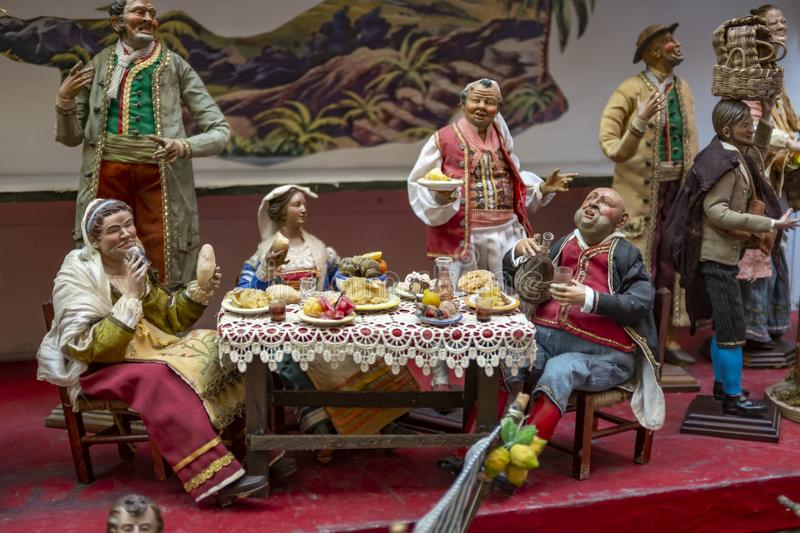 Christmas nativity scene, detail of a Neapolitan Presepe representing a representing a restaurant for lunch royalty free stock photo