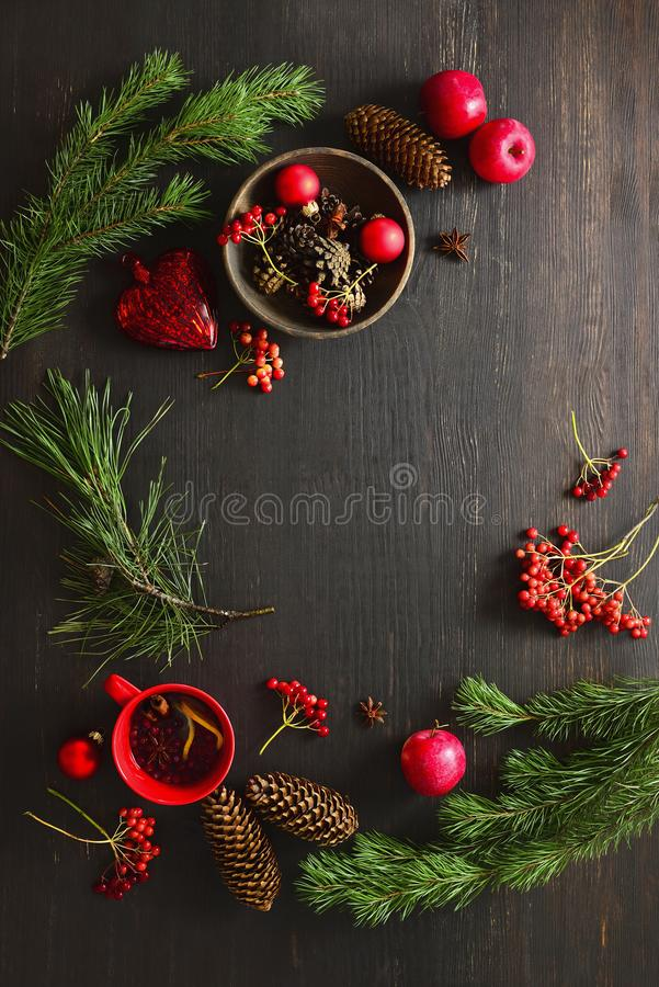 Christmas natural decor stuff on moody rustic table surface. Christmas natural decor stuff on moody rustic table top ready for setting a dinner table, cup of royalty free stock image