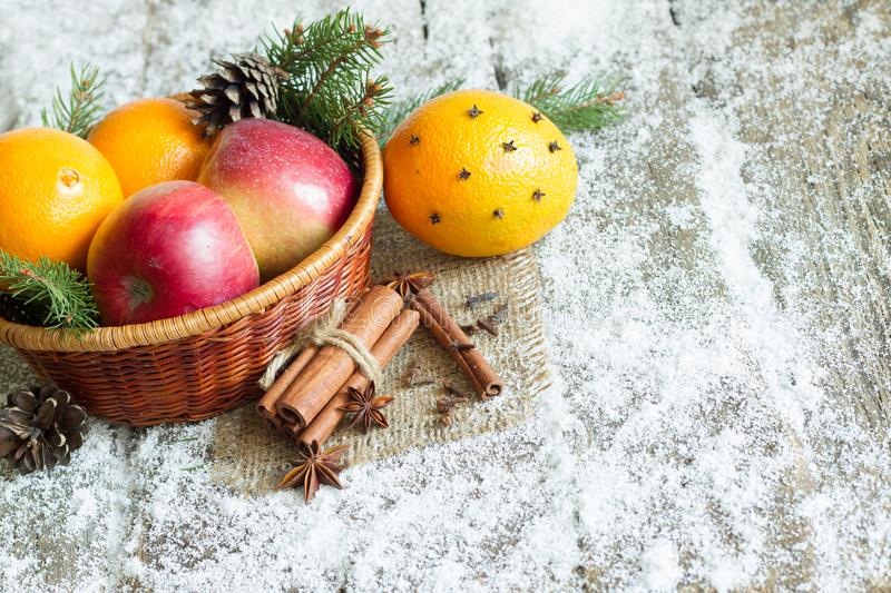 Christmas natural eco ornament with organic fruits on the snowy old table. Closeup stock photography