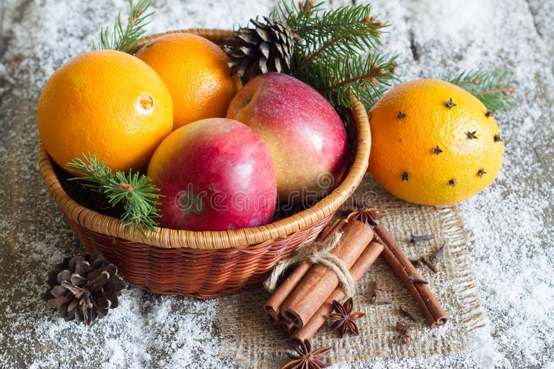 Christmas natural eco ornament with organic fruits on the snowy old table. Closeup royalty free stock photography