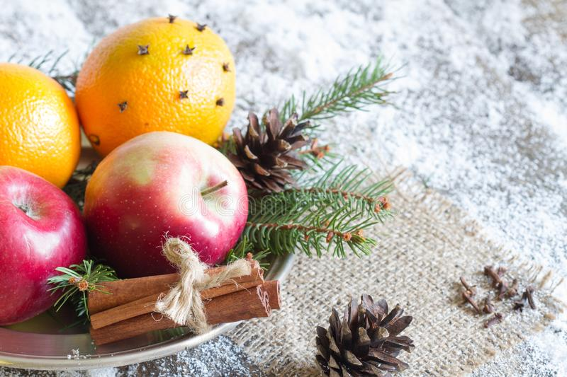 Christmas natural eco ornament with organic fruits on the snowy old table. Closeup stock images