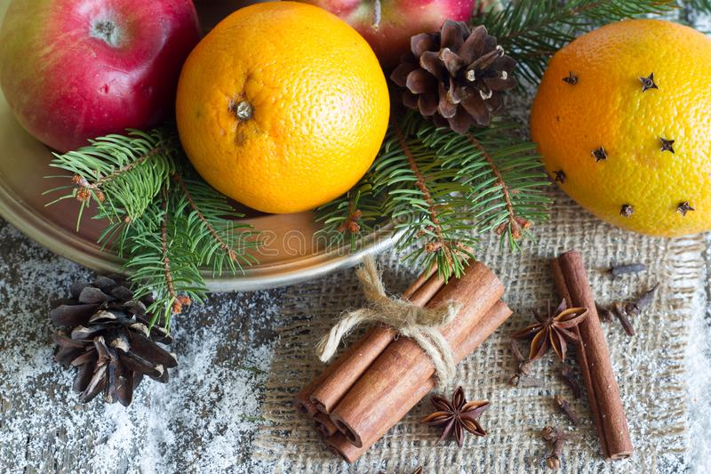 Christmas natural eco ornament with organic fruits on the snowy old table. Closeup stock photo