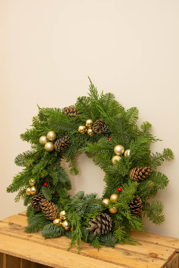 Christmas natural wreath with natural decorations - pinecones, tangerines, dried apples. Close up royalty free stock image