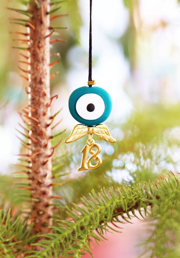 Christmas necklace with evil eye and angel wings. 2018 jewelry stock photo