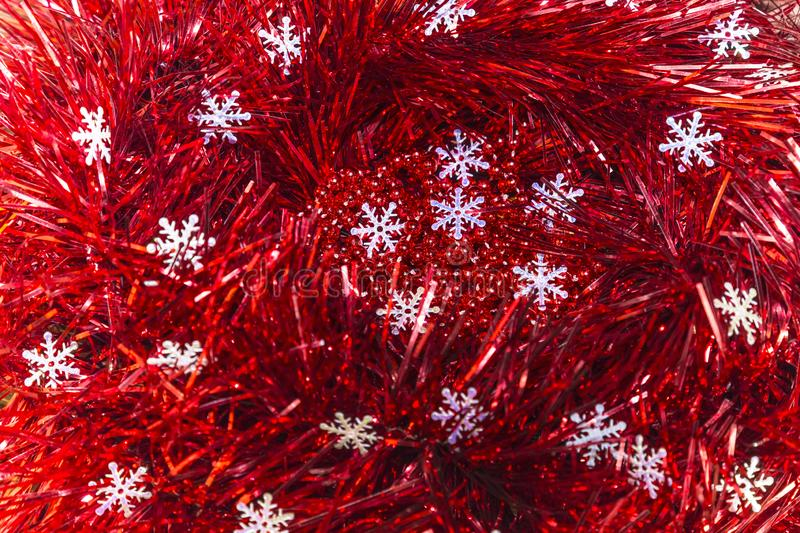 Christmas and New Year abstract festive background of red tinsel royalty free stock photo