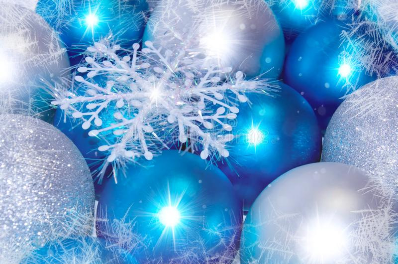 Christmas and New Year background. blue and silver sparkling balls, snowflake ornaments. With snow royalty free stock images