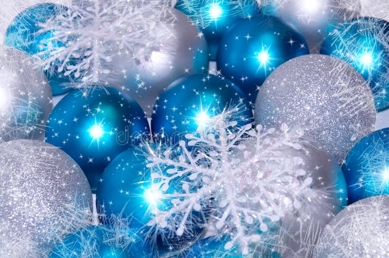 Christmas and New Year background. blue and silver sparkling balls, snowflake ornaments. With snow stock photos