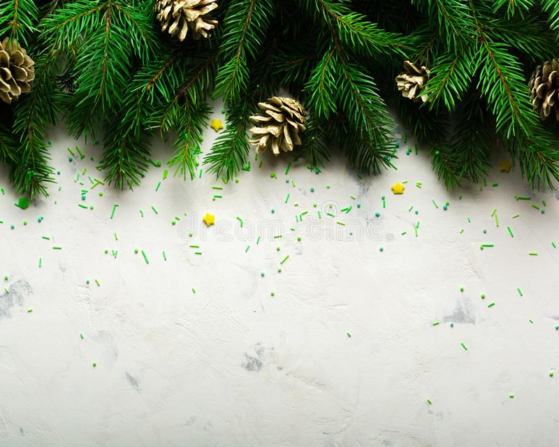 Christmas and New Year background. Christmas tree branch on a white background. A gift for the family. View from above. Copy space stock image