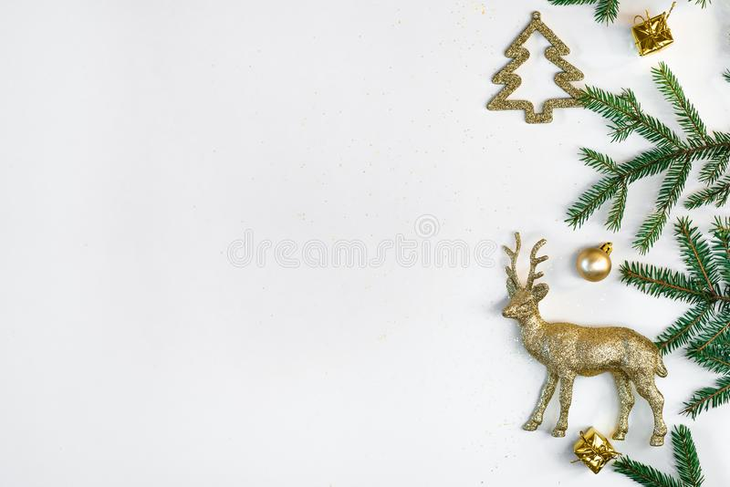 Christmas or new year background. Composition of Christmas decorations and fir branches on white . Flat lay. Symbolic image. White royalty free stock photo