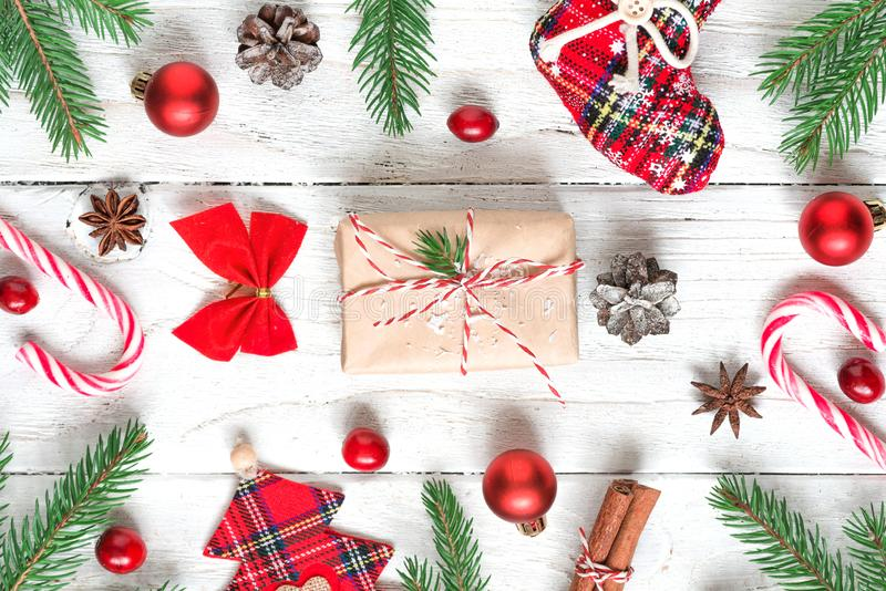 Christmas or New Year background made of fir branches, decorations, berries, candy, gift boxes and pine cones stock photo