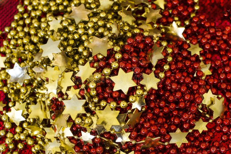 Christmas and New Year background. Red and blue, golden garlands, balls. Golden beads Gold Jewelry. Golden beads. Christmas stock photography