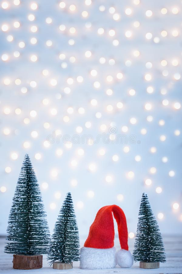 Christmas and New year background with Santa Claus hatand christmas trees. Holiday greeting card royalty free stock images