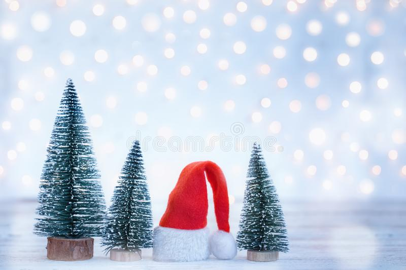 Christmas and New year background with Santa Claus hatand christmas trees. Holiday greeting card stock photo