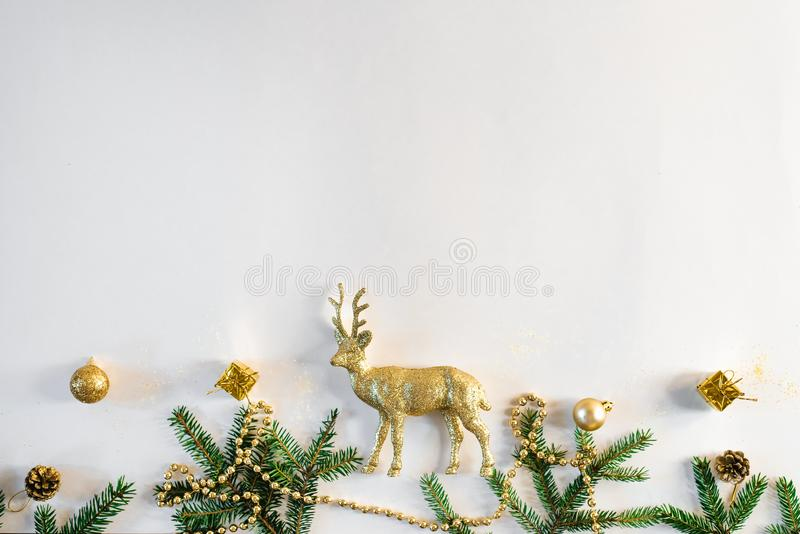 Christmas or new year background. Simple composition of Christmas tree decorations and fir branches, flat layer, empty space for g. Reeting text, greeting card stock images