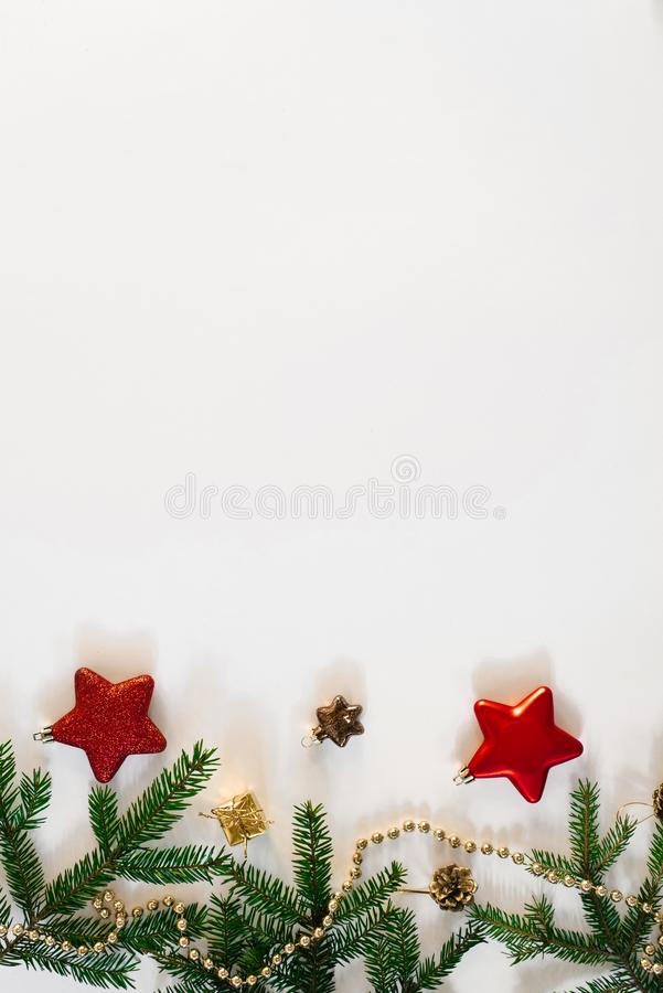 Christmas or new year background. Simple composition of Christmas tree decorations and fir branches, flat layer, empty space for g. Reeting text, greeting card royalty free stock images