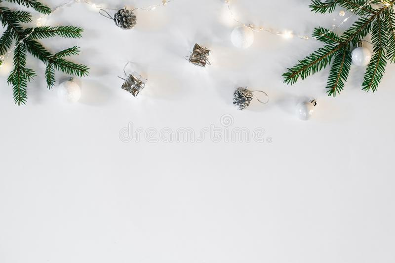 Christmas or new year background. Simple composition of Christmas tree decorations and fir branches, flat layer, empty space for g. Reeting text, greeting card royalty free stock photos