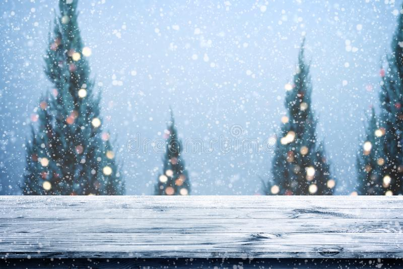 Christmas and New year background with wooden deck table over christmas tree, stock photos