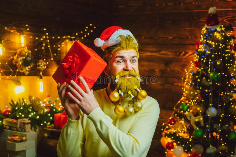 Christmas or New Year barber shop concept. Beard with bauble. Santa in barbershop. Christmas style for modern Santa. royalty free stock images