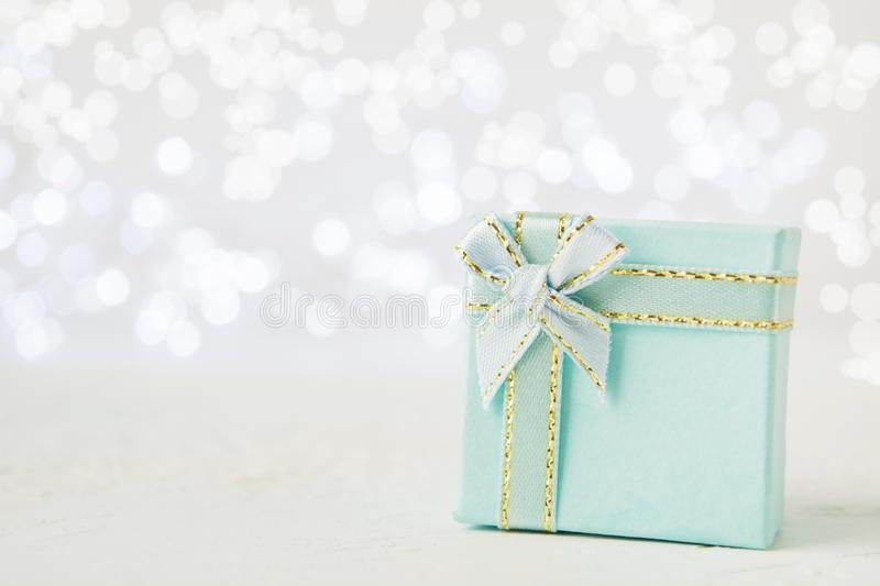 Christmas or New Year blue present with bow stock photography
