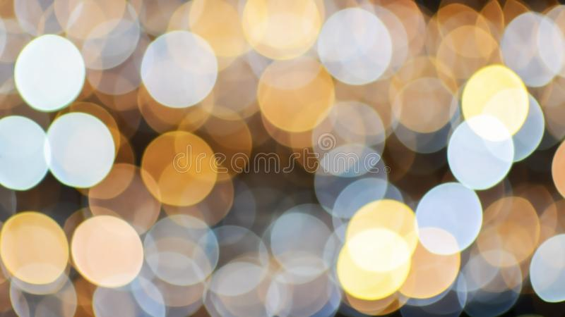 Christmas and new year bokeh lights background. Christmas, new year, club and party bokeh white and gold sparkle lights background royalty free stock images
