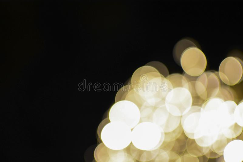 Christmas and new year bokeh lights background. Christmas, new year, club and party bokeh white and gold sparkle lights background stock image